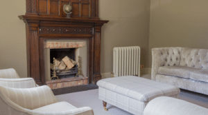 Piccadilly Cast Iron Radiator by Fireplace