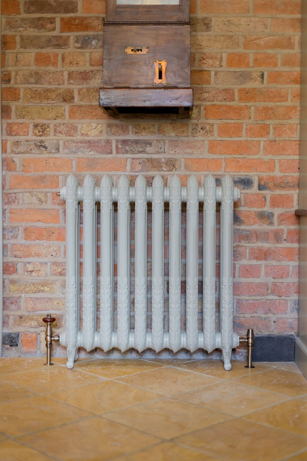 Bone Column Radiator Against Brick Wall